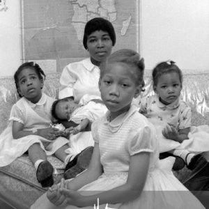 Betty Shabazz, wife of Malcolm X, with their daughters, 1964. Photo by John Launois, © The Estate of John Launois.
